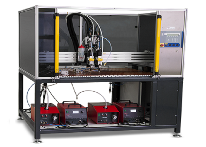 AUTOMATIC WELDING SYSTEM FOR CAPACITOR DISCHARGE